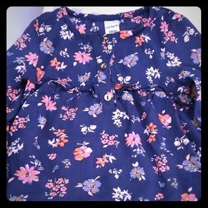 Blue floral shirt with gold buttons.